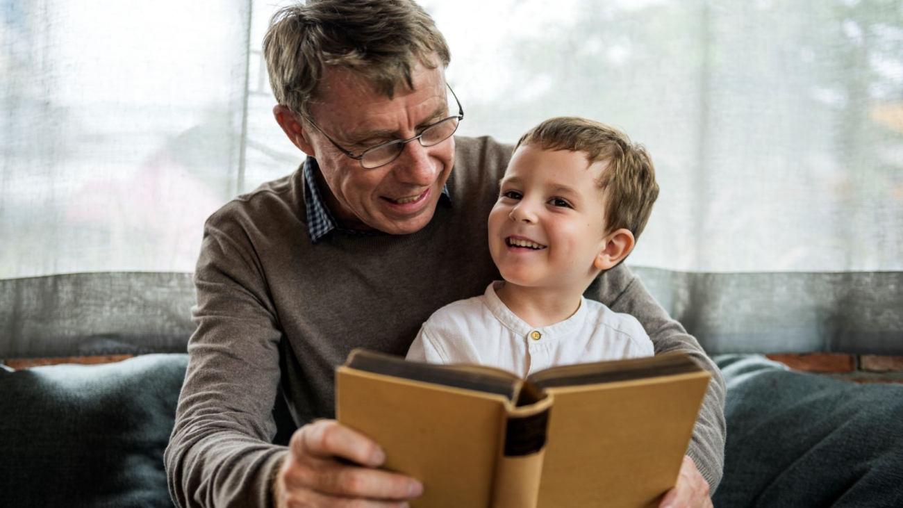 grandfather-and-grandson-reading-book-together