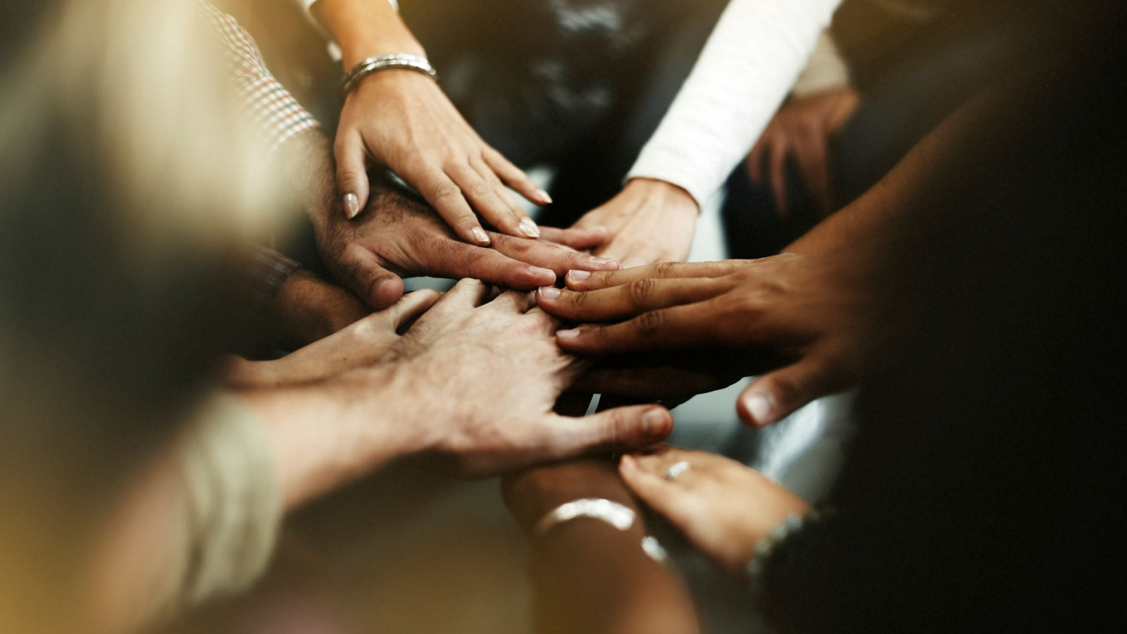 closeup-diverse-people-joining-their-hands2