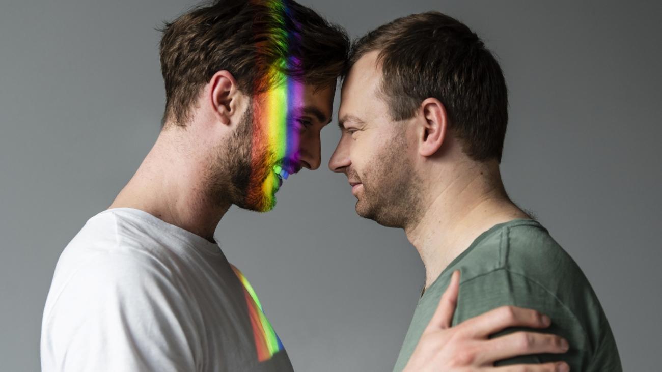male-couple-with-rainbow-symbol